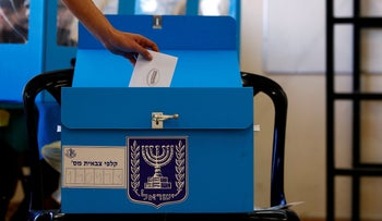 A soldier casts his early vote at a military base near Kibbutz Regavim, last week.
