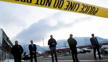 Law enforcement officials wait to address media after deadly shooting in a Colorado supermarket, earlier today