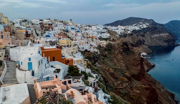 White washed villas adorn the cliffs of the village of Oia, on the northwestern tip of the Greek island of Santorini, in the Aegean Sea