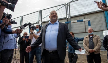 United Arab List Chairman Abbas Mansour arrives to vote in the village of Maghar in the Galilee, today.