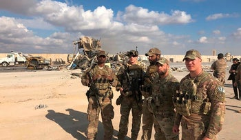U.S. Soldiers stand at a site of Iranian bombing at Ain al-Asad air base in Anbar, Iraq, 2021.