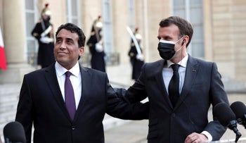 French President Emmanuel Macron, right, and Mohammad Younes Menfi, president of Libya's Presidential Council, left, at the Elysee Palace in Paris, France Tuesday.