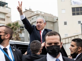 Prime Minister Benjamin Netanyahu giving a victory salute to supporters on Election Day.