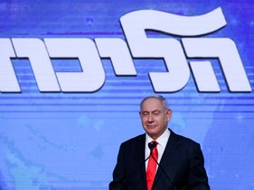 Netanyahu speaking in front of his supporters on election night.