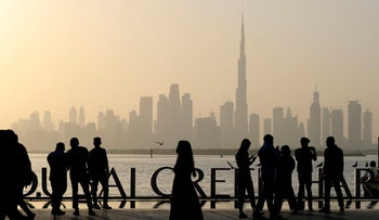 People enjoy their weekend with the view of city skyline and the world tallest tower, Burj Khalifa, in Dubai, United Arab Emirates.