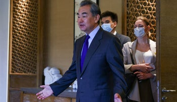 Chinese Foreign Minister Wang Yi meeting with his Russian counterpart, this month
