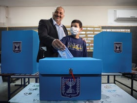Mansour Abbas, leader of the United Arab List, votes for Israel's general election at a polling station in Maghar.