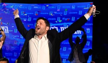 Religious Zionism chairman Bezalel Smotrich celebrating after Tuesday's exit polls