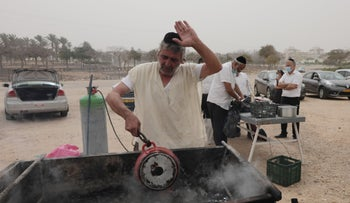 Making dishes kosher for Pesach in Netivot on Tuesday.