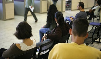 People wait to be served at Israel's employment service