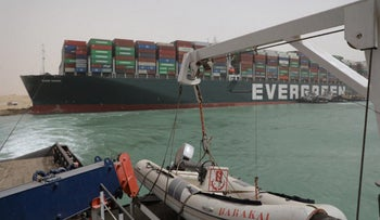 Egyptian tug boats trying to free Taiwan-owned cargo Ever Green impeding all traffic across the waterway of Egypt's Suez Canal, today.
