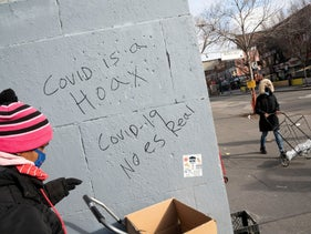 She believes that powerful companies, powerful governments and powerful people have lured us into believing a big lie: 'COVID is a Hoax' graffiti in the Bronx earlier this year