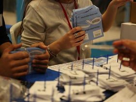 The Central Elections Committee counts votes, Thursday.