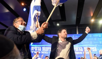 Religious Zionism's Itamar Ben-Gvir and Bezalel Smotrich celebrate after the release of exit polls, Tuesday.