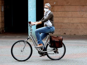 A woman rides her bike on Election Day, in Ashdod, earlier this week.