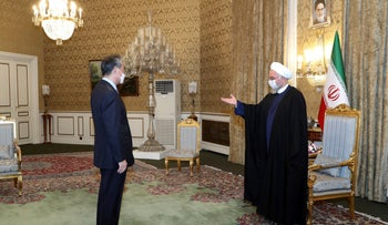 President Rohani welcomes Chinese Foreign Minister Wang Yi at the start of their meeting in Tehran, today.