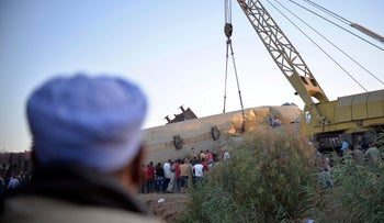 The wreckage of two trains that collided in the Tahta district, south of the Egyptian capital Cairo, on Friday.