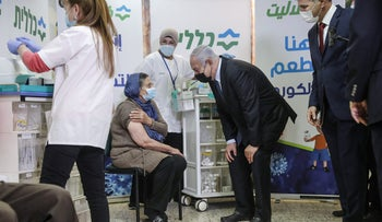 Prime Minister Benjamin Netanyahu during a visit at a coronavirus vaccination center in the Arab town of Tira, this month