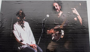 Photos of singer Achinoam Nini and musician Ofra Yitzhaki that were hung up at the entrance to Jerusalem and vandalized two weeks ago.