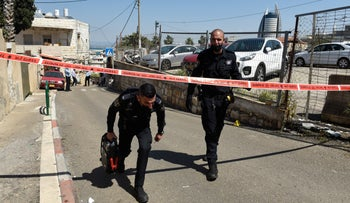 Police officers at the scene in Haifa, on Monday.