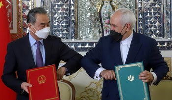 China's Foreign Minister Wang Yi and Iran's Foreign Minister Mohammad Javad Zarif bumping elbows during the signing ceremony of a 25-year cooperation agreement in Tehran last week.