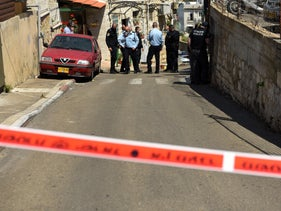 The scene of the incident, outside the family's home in the neighborhood of Wadi Nisnas in Haifa, Monday