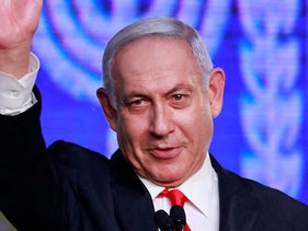 Benjamin Netanyahu waves to supporters, last Tuesday.