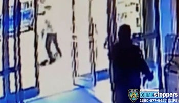 This image taken from surveillance video provided by the New York City Police Department shows a person of interest, background center, assaulting an Asian American woman, on ground, Monday,