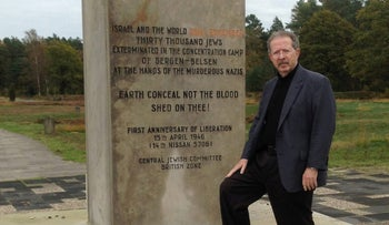 FILE PHOTO: Menachem Rosensaft stands before a monument to the victims of the Bergen-Belsen concentration camp in Germany.