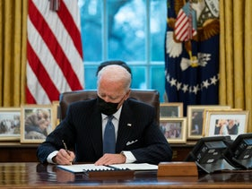 President Joe Biden signs an Executive Order reversing the Trump era ban on transgender individuals serving in military, in the Oval Office of the White House.