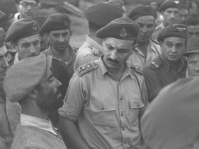 """General Yigael Yadin at a new immigrant transit camp, in 1950. """"Mizrahi soldiers were at the bottom of the military hierarchy of prestige and masculinity."""""""