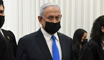 Benjamin Netanyahu in court before the start of a hearing in his corruption trial, two months ago.