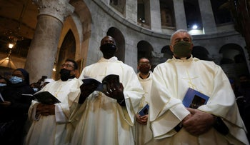 Worshipers at the Church of the Holy Sepulcher in Jerusalem.