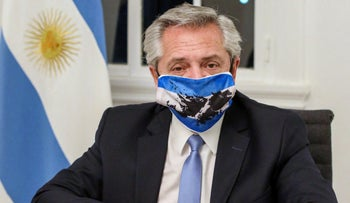 FILE PHOTO: President Alberto Fernandez wearing a face mask with the colors of Argentina's national flag.