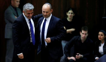 Yair Lapid and Naftali Bennett at the Knesset in 2013.
