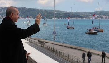 Turkish President Recep Tayyip Erdogan saluting vessels as they sail the Bosporus Strait in Istanbul last year.