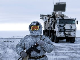 In this photo taken on Wednesday, April 3, 2019, a Russian solder stands guard as Pansyr-S1 air defense system on the Kotelny Island, part of the New Siberian Islands archipelago located between the Laptev Sea and the East Siberian Sea, Russia