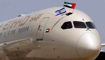 An Etihad Airways aircraft displays Israeli and Emirati flags after landing at Ben-Gurion International Airport, on the company's first scheduled commercial flight from Abu Dhabi.