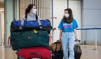 Two Israelis arriving at Ben Gurion Airport last month.