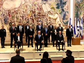 Israeli party leaders pose for a family photo after the new Knesset was sworn in, on Tuesday.
