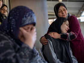 The mother and sister of Munir Anabtawi mourn at their home before his funeral, who was killed by Israeli police, in Haifa, March 30, 2021.