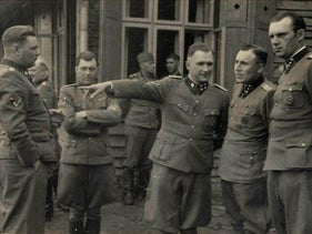 Josef Mengele with Nazi officers.