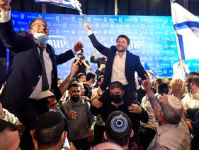 Religious Zionism head Bezalel Smotrich (R) and Otza Yehudit head Itamar Ben Gvir celebrating the exit poll results for the 2021 elections