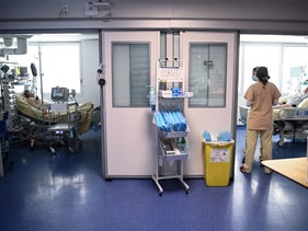 Medical staff members tend to patients in the COVID intensive care unit in Paris, France.