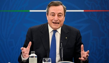 Mario Draghi gestures during a press conference in Rome Thursday, April, 2021.