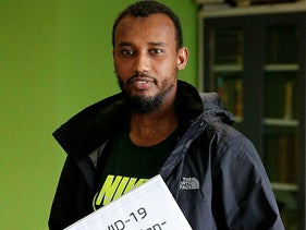 Abdiaziz Mohamed, who is in charge of coordinating vaccines for the Maine Muslim Community Center poses Wednesday, April 7, 2021 in the prayer room of the Maine Muslim Community Center in Portland, Maine