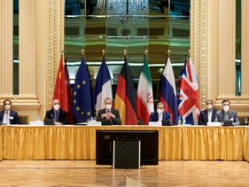 EU official Enrique Mora and Iranian diplomat Abbas Araghchi wait for the start of a meeting on the nuclear deal in Vienna on Tuesday.