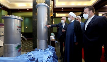 Iranian President Rouani, second right, listens to head of the Atomic Energy Organization Ali Akbar Salehi while visiting an exhibition of Iran's new nuclear achievements in Tehran, on Saturday.
