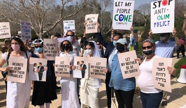 Pregnant women, brides-to-be and other immigrants protest in front of the Knesset last week so their family members will be able to enter Israel.