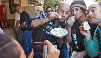 A Birthright culinary tour eats hummus in Tel Aviv, in 2012.